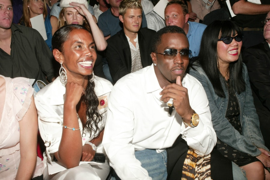 "NEW YORK - SEPTEMBER 15: (HOLLYWOOD REPORTER OUT) Sean ""P. Diddy"" Combs and girlfriend Kim Porter attend the Marc Jacobs Spring/Summer 2004 Collection at the Manhattan Armory during the 7th on Sixth Mercedes-Benz Fashion Week on September 15, 2003 in New York City. (Photo by Evan Agostini/Getty Images)"