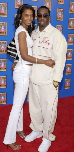 "LOS ANGELES - FEBRUARY 15:  Recording artist and producer Sean ""P Diddy"" Combs with his girlfriend Kim Porter attend the 2004 NBA All-Star Game held on February 15, 2004 at the Staples Center, in Los Angeles, California. (Photo by Vince Bucci/Getty Images)"
