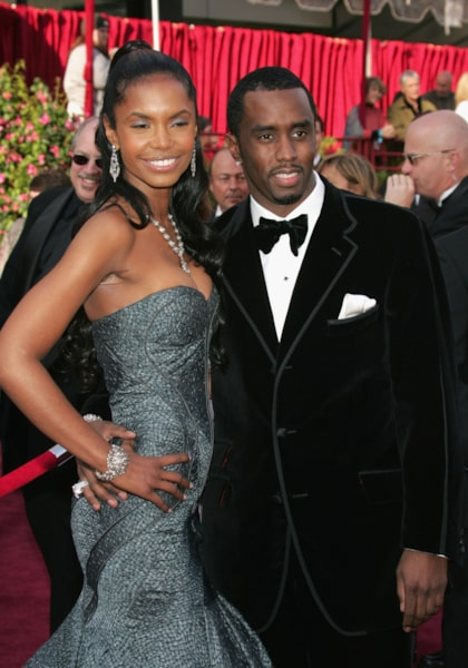 "HOLLYWOOD, CA - FEBRUARY 27:  Rapper Sean ""P Diddy"" Combs (R) and Kim Porter arrive at the 77th Annual Academy Awards at the Kodak Theater on February 27, 2005 in Hollywood, California. (Photo by Carlo Allegri/Getty Images)"