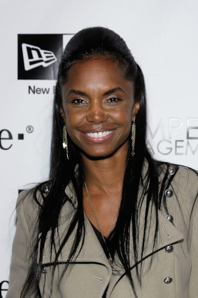 "HOLLYWOOD - DECEMBER 08:  Kim Porter attends the Famous Stars and Straps 10th Anniversary and Snoop Dogg's 10th album release ""Malice N Wonderland"" party at Vanguard on December 8, 2009 in Hollywood, California.  (Photo by Noel Vasquez/Getty Images)"